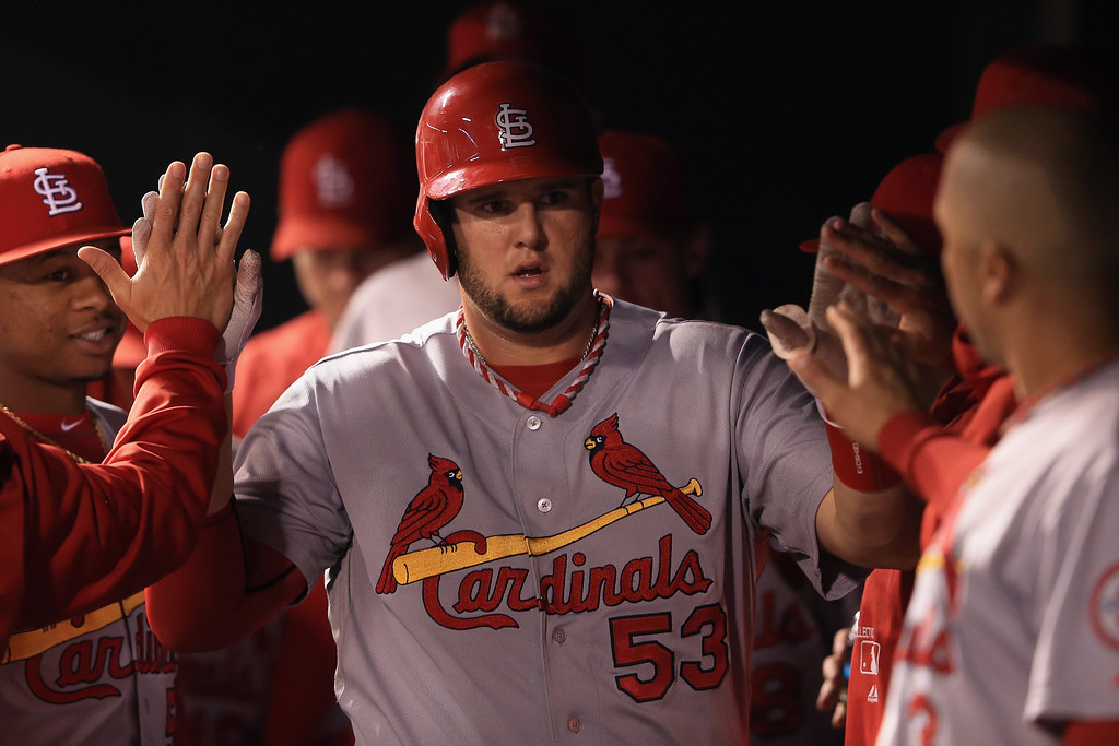 . Matt Adams #53 of the St. Louis Cardinals celebrates in the dugout after scoring on a single by David Freese #23 of the St. Louis Cardinals to tie the score 1-1 with the Colorado Rockies in the fifth inning at Coors Field on September 16, 2013 in Denver, Colorado.  (Photo by Doug Pensinger/Getty Images)