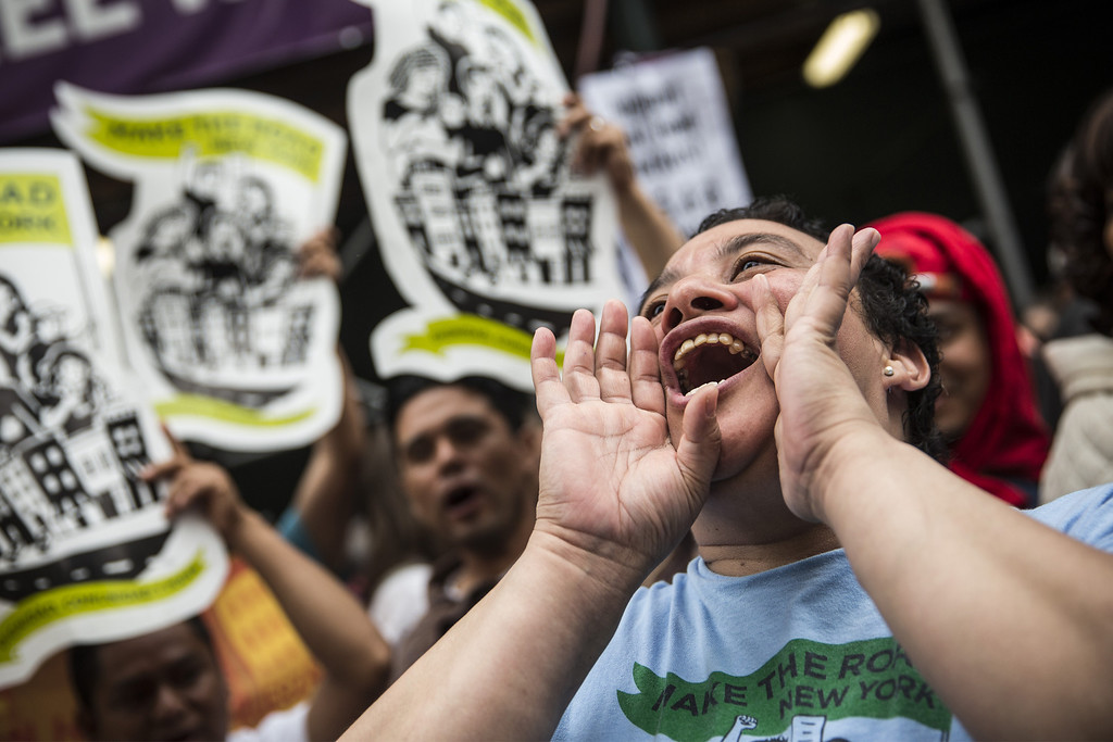 . Protesters demanding higher wages for fast food workers chant during a massive rally on May 15, 2014 in New York City.  (Photo by Andrew Burton/Getty Images)
