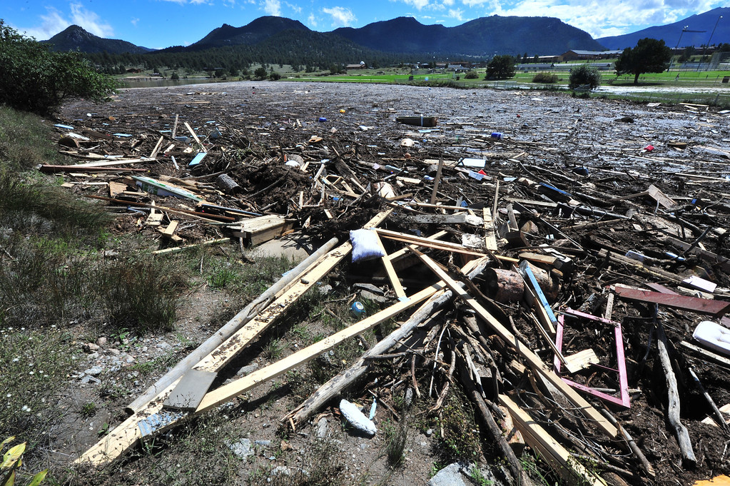 . Piles of refuse clog the south side of Lake Estes on Monday, September 16, 2013. The pile includes mattresses, bottles, coolers, pieces of homes and human waste. Walt Hester/Estes Park Trail-Gazette