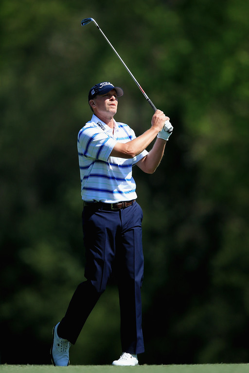 . Steve Stricker of the United States hits an approach shot on the fifth hole during the first round of the 2014 Masters Tournament at Augusta National Golf Club on April 10, 2014 in Augusta, Georgia.  (Photo by David Cannon/Getty Images)