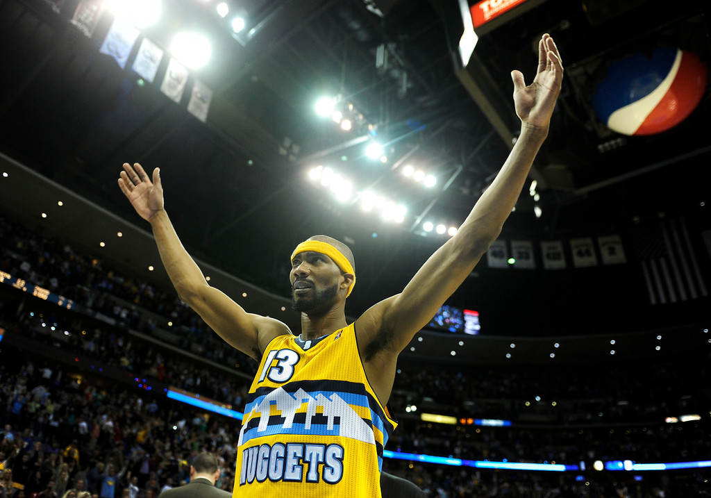 . DENVER, CO. - MARCH 21: Corey Brewer (13) of the Denver Nuggets celebrated the win Thursday after sinking three straight shot from the foul line. The Denver Nuggets defeated the Philadelphia 76ers 101-100 Thursday night, March 21, 2013 at the Pepsi Center. The Nuggets are on a 14-game record winning streak that is a team record. (Photo By Karl Gehring/The Denver Post)