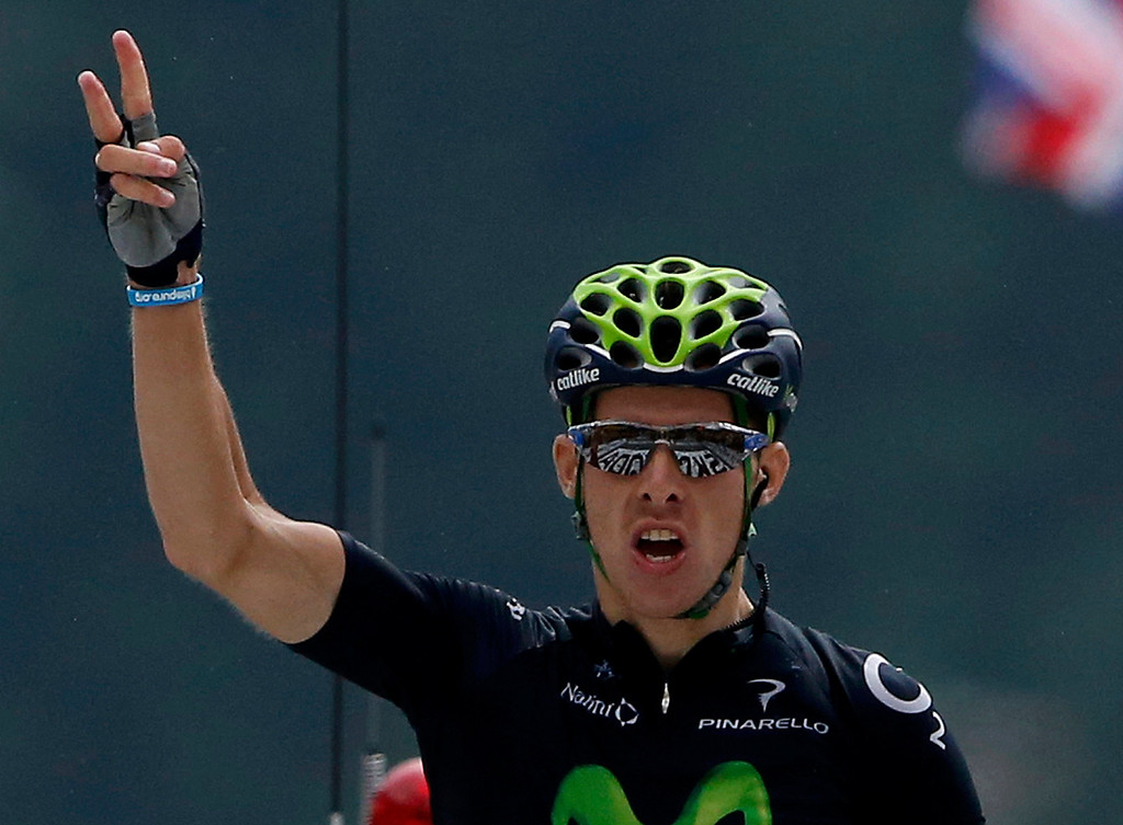 . Movistar team rider Rui Alberto Costa of Portugal celebrates as he crosses the finish line to win the 204.5 km nineteenth stage of the centenary Tour de France cycling race from Bourg d\'Oisans to Le Grand Bornand, in the French Alps, July 19, 2013. REUTERS/Jean-Paul Pelissier