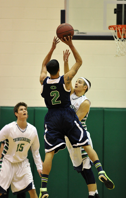 . HIGHLANDS RANCH, CO. - MARCH 02: Taren Williams of Overland High School #2 makes the basket over Hunter O\'Neill of ThunderRidge High School #22 by O\'Neill\'s teammate Nolan Zarlin #15 during the 2nd round of 5A playoff game at ThunderRidge High School. March 2, 2013. Highlands Ranch, Colorado. ThunderRidge won 67-57. (Photo By Hyoung Chang/The Denver Post)