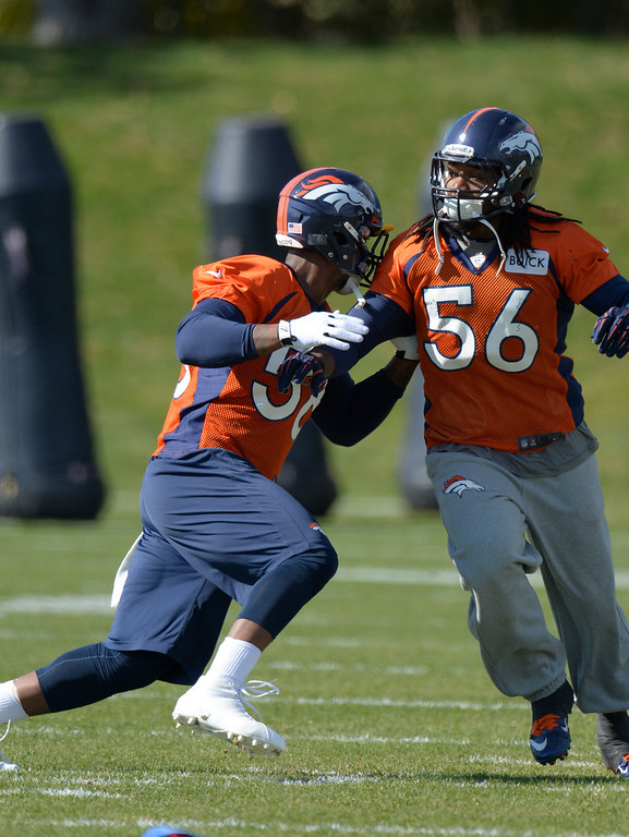 . Denver Broncos outside linebacker Von Miller (58) runs through drills with Denver Broncos outside linebacker Nate Irving (56) during his first day back to practice October 16, 2013 at Dove Valley. Miller just finished serving a six game suspension. (Photo by John Leyba/The Denver Post)