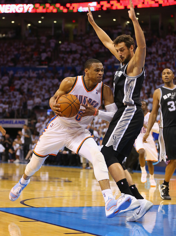 . OKLAHOMA CITY, OK - MAY 31:  Russell Westbrook #0 of the Oklahoma City Thunder drives with the ball against Marco Belinelli #3 of the San Antonio Spurs in the second half during Game Six of the Western Conference Finals of the 2014 NBA Playoffs at Chesapeake Energy Arena on May 31, 2014 in Oklahoma City, Oklahoma. (Photo by Ronald Martinez/Getty Images)
