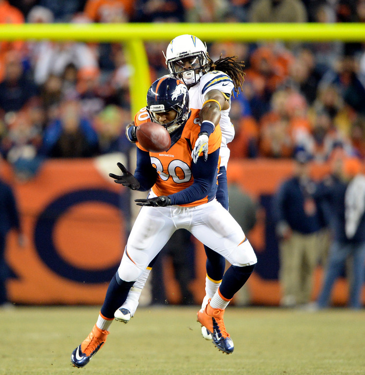 . DENVER, CO - DECEMBER 12: Denver Broncos tight end Julius Thomas (80) makes a catch and is taken down by San Diego Chargers defensive back Jahleel Addae (37) in the first quarter.  The Denver Broncos vs. the San Diego Chargers at Sports Authority Field at Mile High in Denver on December 12, 2013. (Photo by Hyoung Chang/The Denver Post)