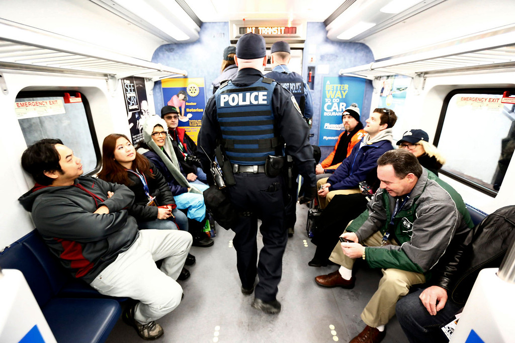 . Police walk through a train on Sunday, Feb. 2, 2014, in Secaucus, N.J. The Seattle Seahawks are scheduled to play the Denver Broncos in NFL football\'s Super Bowl XLVIII game on Sunday evening at MetLife Stadium in East Rutherford, N.J. (AP Photo/Matt Rourke)