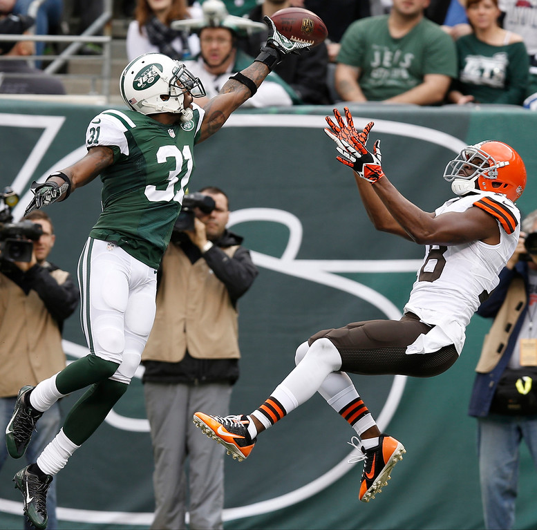 . New York Jets cornerback Antonio Cromartie (31) deflects a pass to Cleveland Browns\' Greg Little (18) in the end zone during the first half of an NFL football game on Sunday, Dec. 22, 2013, in East Rutherford, N.J.  (AP Photo/Kathy Willens)