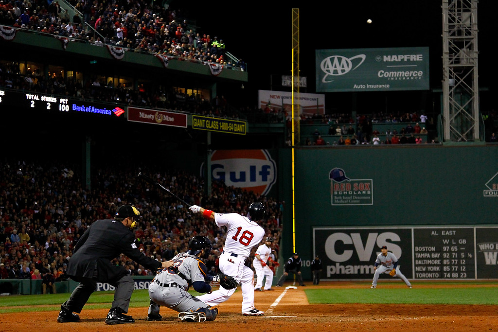 . BOSTON, MA - OCTOBER 19:  Shane Victorino #18 of the Boston Red Sox hits a grand slam home run against Jose Veras #31 of the Detroit Tigers in the seventh inning during Game Six of the American League Championship Series at Fenway Park on October 19, 2013 in Boston, Massachusetts.  (Photo by Jared Wickerham/Getty Images)