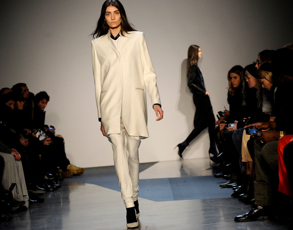 . The Helmut Lang Fall 2013 collection is modeled during Fashion Week, Friday, Feb. 8, 2013, in New York. (AP Photo/Louis Lanzano)