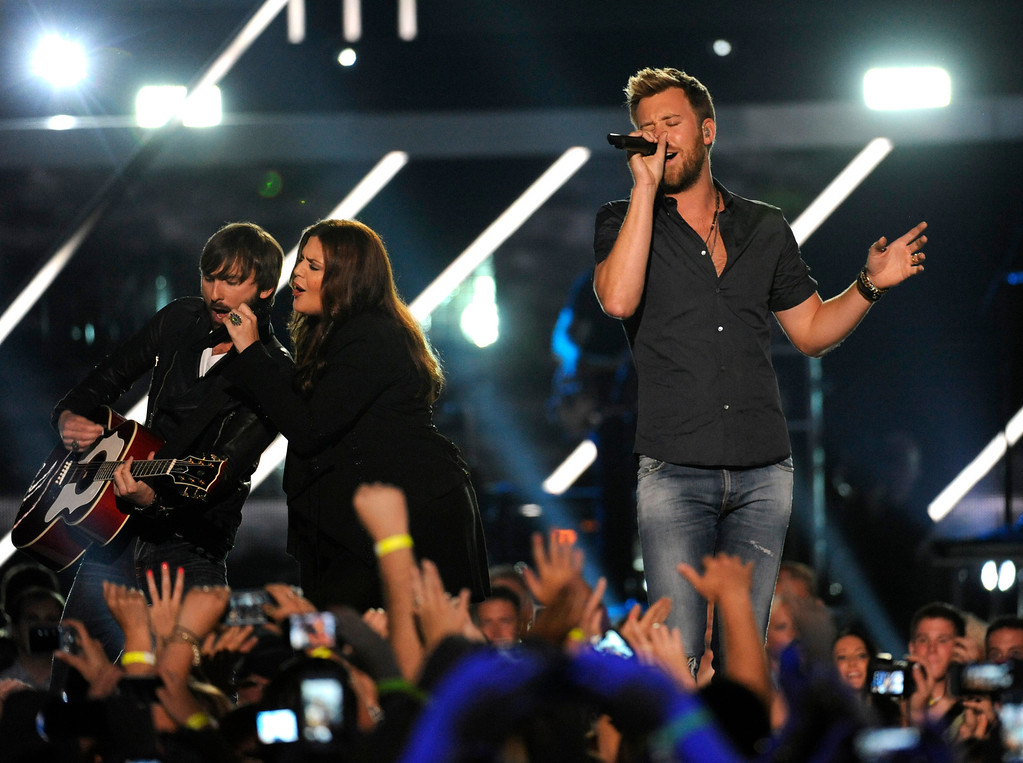 . Members of Lady Antebellum, from left, Dave Haywood, Hillary Scott and Charles Kelley perform at the 2013 CMT Music Awards at Bridgestone Arena on Wednesday, June 5, 2013, in Nashville, Tenn. (Photo by Donn Jones/Invision/AP)