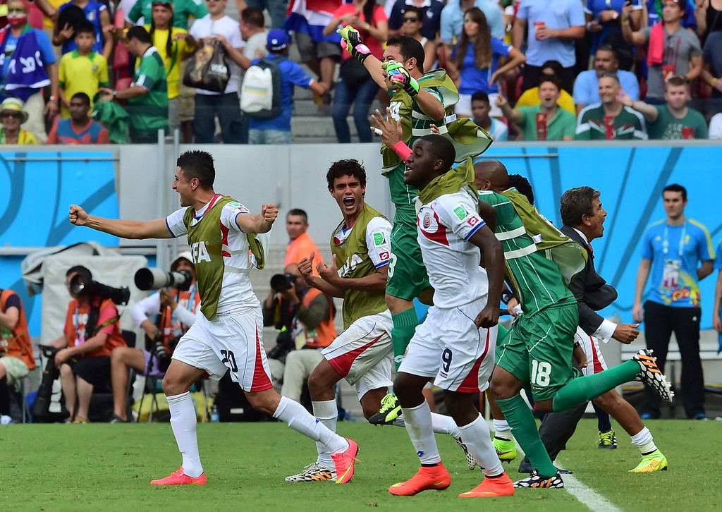 . Costa Rica\'s players celebrate after a Group D football match between Italy and Costa Rica at the Pernambuco Arena in Recife during the 2014 FIFA World Cup on June 20, 2014.  GIUSEPPE CACACE/AFP/Getty Images