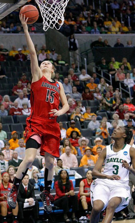 . Louisville\'s Megan Deines (15) shoots over Baylor\'s Jordan Madden (3) during the second half of a regional semifinal game in the women\'s NCAA college basketball tournament in Oklahoma City, Sunday, March 31, 2013.  Louisville won 82-81.  (AP Photo/Alonzo Adams)