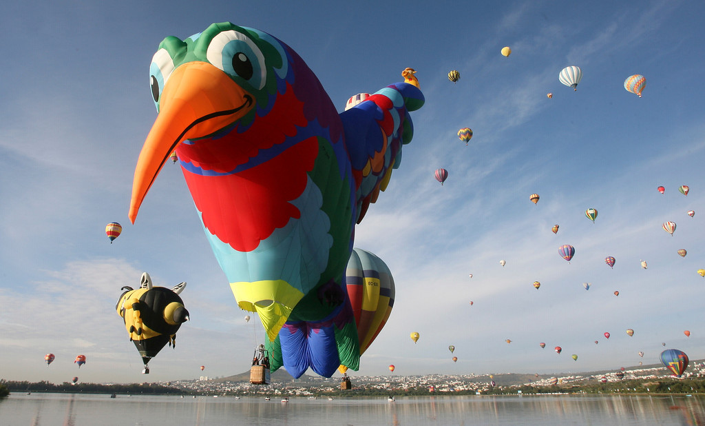 . Balloons take off over the Palote dam during the Hot Air Balloon Festival in Leon, Mexico, Friday, Nov. 15, 2013. More than 200 balloons from different countries participated in this year\'s festival. (AP Photo/Mario Armas)