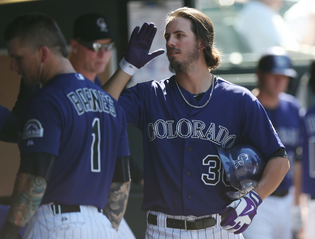 . Colorado Rockies starting pitcher Christian Bergman, right, is congratulated after being pulled against the San Francisco Giants in the sixth inning of the Rockies\' 9-2 victory in a baseball game in Denver, Wednesday, Sept. 3, 2014. (AP Photo/David Zalubowski)