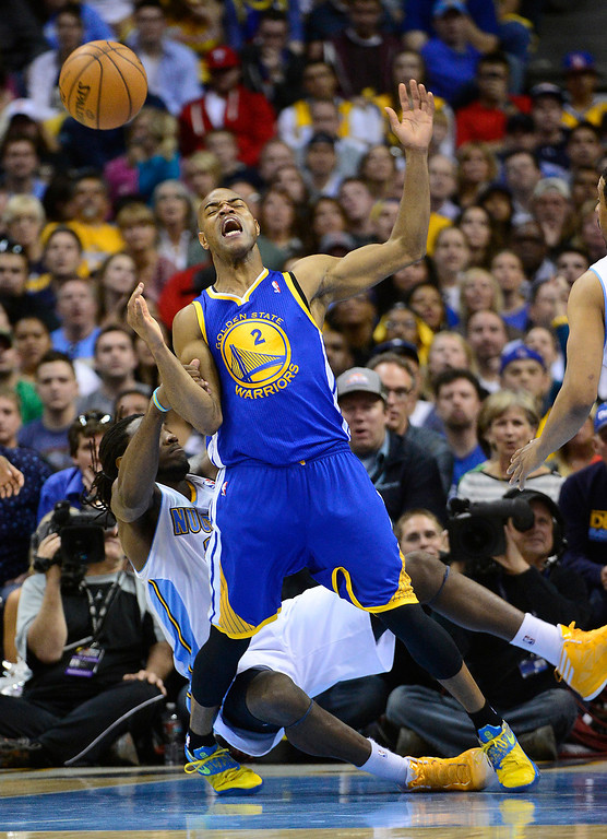 . Golden State Warriors point guard Jarrett Jack (2) is pulled down by Denver Nuggets small forward Kenneth Faried (35). The Denver Nuggets took on the Golden State Warriors in Game 5 of the Western Conference First Round Series at the Pepsi Center in Denver, Colo. on April 30, 2013. (Photo by AAron Ontiveroz/The Denver Post)