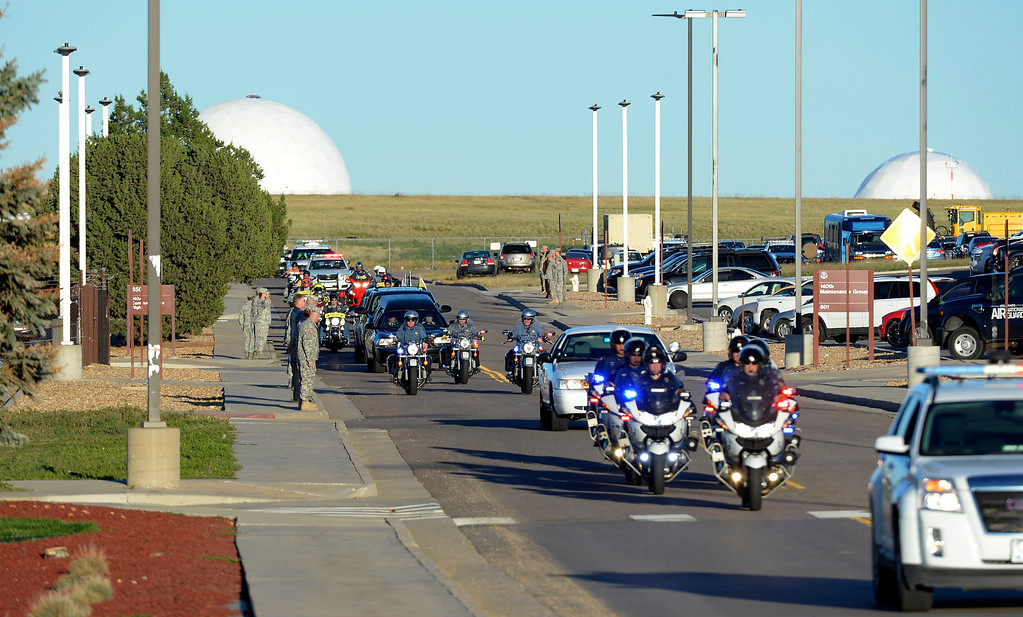 . The procession leads the hearse carrying the casket of staff sergeant Liam Nevins away from Buckley AFB. Military officials brought the body of special forces staff sergeant Liam Nevins, 32, home from Dover AFB September 30, 2013 at Buckley AFB. Nevins, of Denver, was killed two weekends ago in Afghanistan. (Photo by John Leyba/The Denver Post)