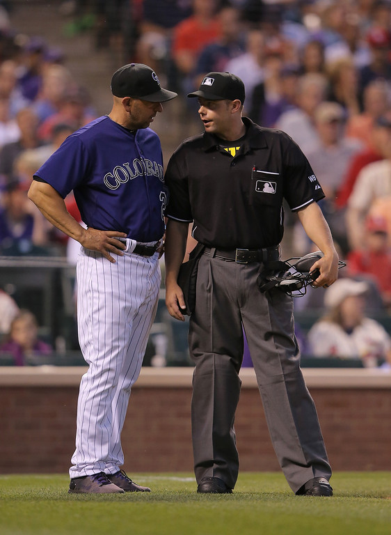 . Manager Walt Weiss #22 of the Colorado Rockies requests a replay review with umpire Will Little after he made the call that Matt Carpenter #13 of the St. Louis Cardinals was hit by a pitch by Franklin Morales #56 of the Colorado Rockies in the seventh inning at Coors Field on June 23, 2014 in Denver, Colorado. The call was upheld after the review.  (Photo by Doug Pensinger/Getty Images)