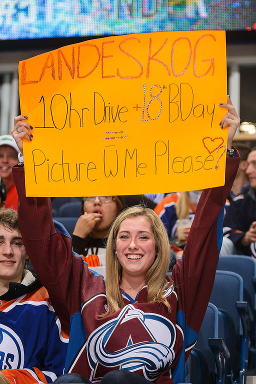 . A fan cheers for Gabriel Landeskog #92 of the Colorado Avalanche during warm-ups prior to an NHL game against the Edmonton Oilers at Rexall Place on April 8, 2014 in Edmonton, Alberta, Canada. (Photo by Derek Leung/Getty Images)