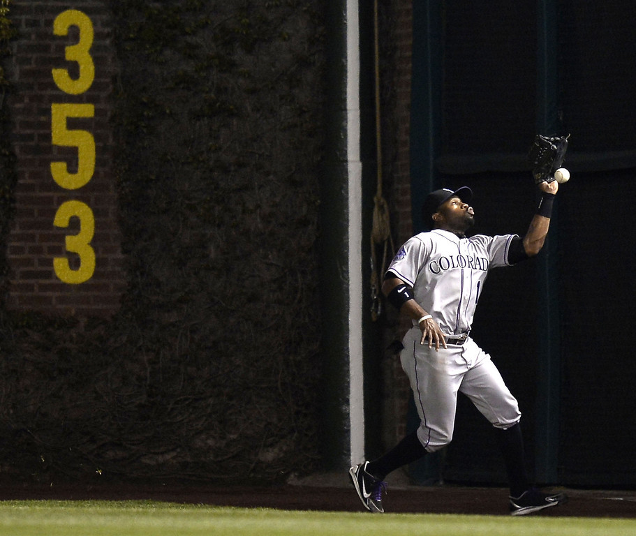 . Right fielder Eric Young Jr. #1 of the Colorado Rockies drops a fly ball hit by Starlin Castro (not pictured) of the Chicago Cubs during the eighth inning on May 14, 2013 at Wrigley Field in Chicago, Illinois.    (Photo by Brian Kersey/Getty Images)