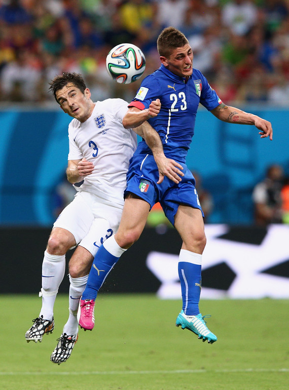 . Marco Verratti of Italy and Leighton Baines of England go up for a header during the 2014 FIFA World Cup Brazil Group D match between England and Italy at Arena Amazonia on June 14, 2014 in Manaus, Brazil.  (Photo by Adam Pretty/Getty Images)