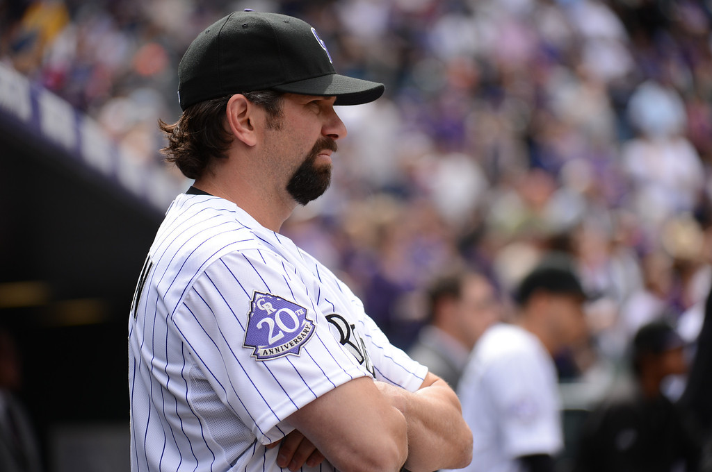 . Todd Helton (17) of the Colorado Rockies waits for the start of the game from the dugout. (Photo by Hyoung Chang/The Denver Post)