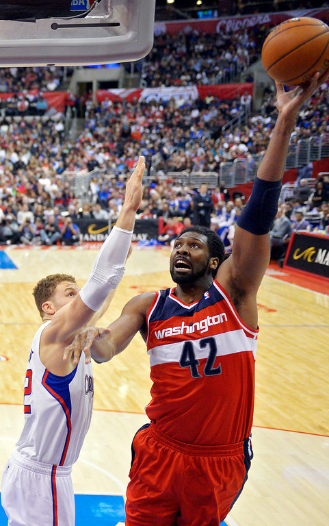 . Washington Wizards center Nene, left, of Brazil, puts up a shot as Los Angeles Clippers forward Blake Griffin defends during the first half of their NBA basketball game, Saturday, Jan. 19, 2013, in Los Angeles.  (AP Photo/Mark J. Terrill)