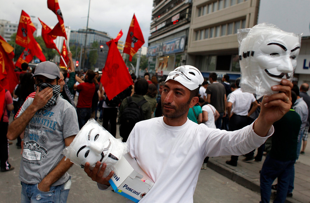 . A man sells Guy Fawkes masks during an anti-government protest in Ankara June 4, 2013.  REUTERS/Umit Bektas