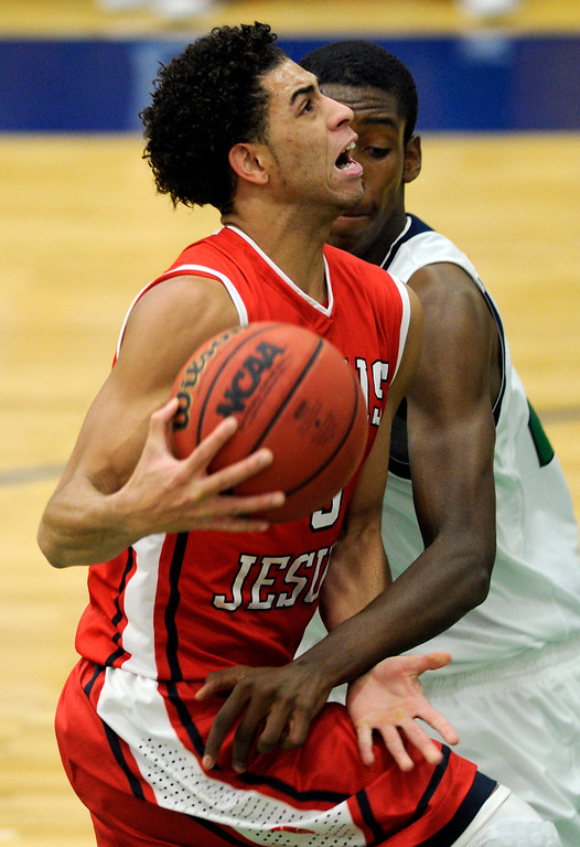 . Blazers center De\'Ron Davis (20) got Regis guard Josh Perkins (3) on the arm for a foul in the first half. The Overland High School boy\'s basketball team defeated Regis Jesuit 80-66 Tuesday night, December 11, 2012.  Karl Gehring/The Denver Post