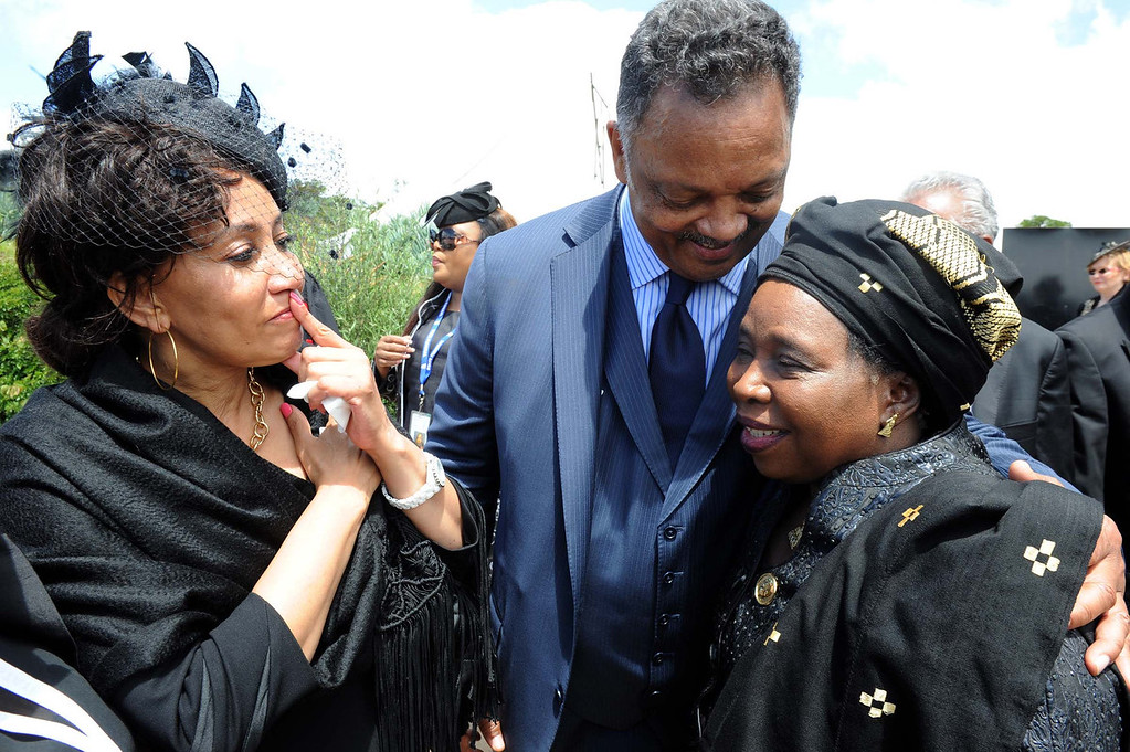 . Jesse Jackson meets Dr Nkosazana Dlamini Zuma, right,  and Lindiwe Sisulu, at Nelson Mandela\'s burial service, in Qunu, South Africa Sunday, Dec. 15, 2013.  (AP Photo/Elmond Jiyane, GCIS)