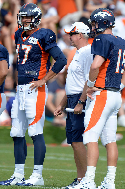 . Denver Broncos QB Brock Osweiler (17) and Peyton Manning (18) talks with head coach John Fox during training camp August 1, 2013 at Dove Valley. (Photo By John Leyba/The Denver Post)