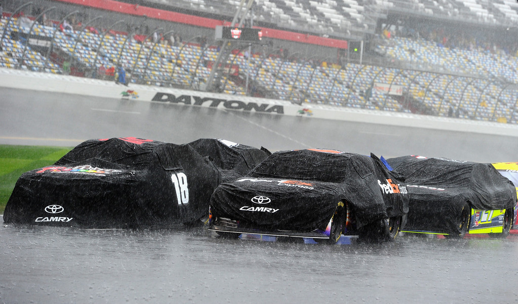. Cars are seen on pit road during a rain delay of the NASCAR Sprint Cup Series Daytona 500 at Daytona International Speedway on February 23, 2014 in Daytona Beach, Florida.  (Photo by Robert Laberge/Getty Images)