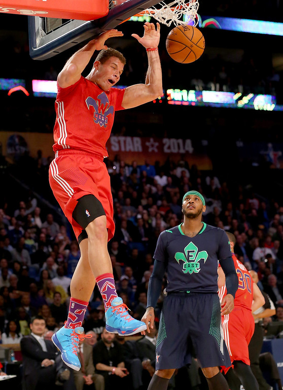 . The Western Conference\'s Blake Griffin #32 of the Los Angeles Clippers dunks the ball as Eastern Conference\'s LeBron James #6 of the Miami Heat defends during 2014 NBA All-Star game at the Smoothie King Center on February 16, 2014 in New Orleans, Louisiana.  (Photo by Ronald Martinez/Getty Images)