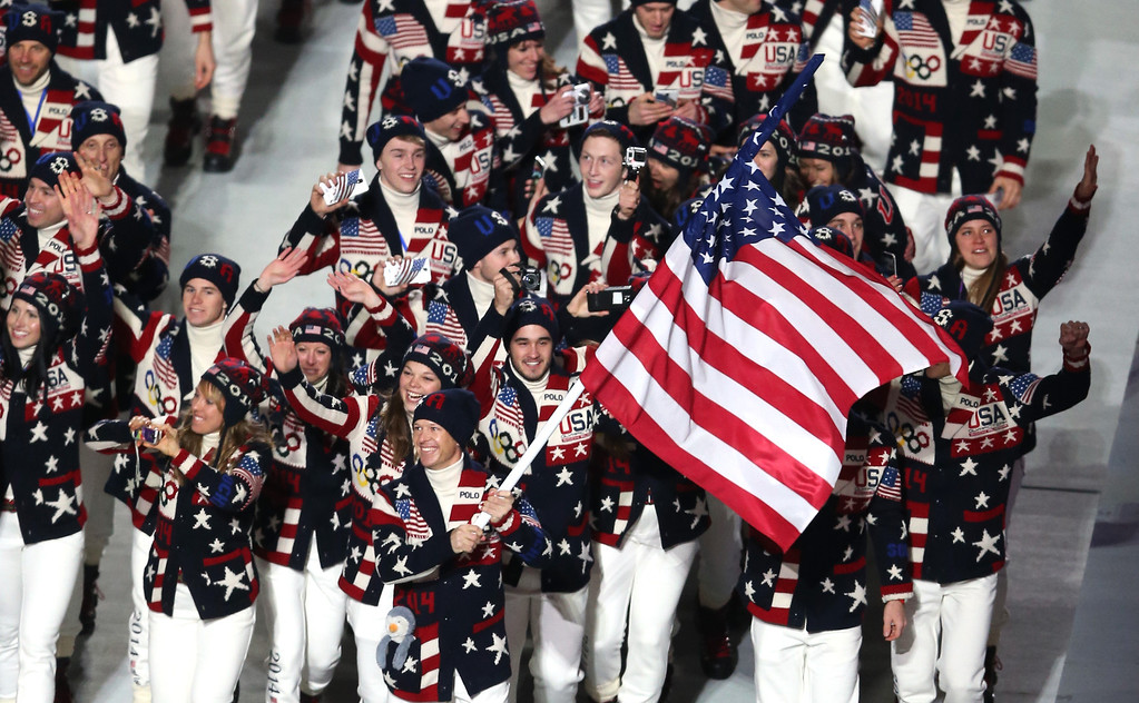 . Nordic combined skier Todd Lodwick of the United States Olympic team carries his country\'s flag during the Opening Ceremony of the Sochi 2014 Winter Olympics at Fisht Olympic Stadium on February 7, 2014 in Sochi, Russia.  (Photo by Bruce Bennett/Getty Images)