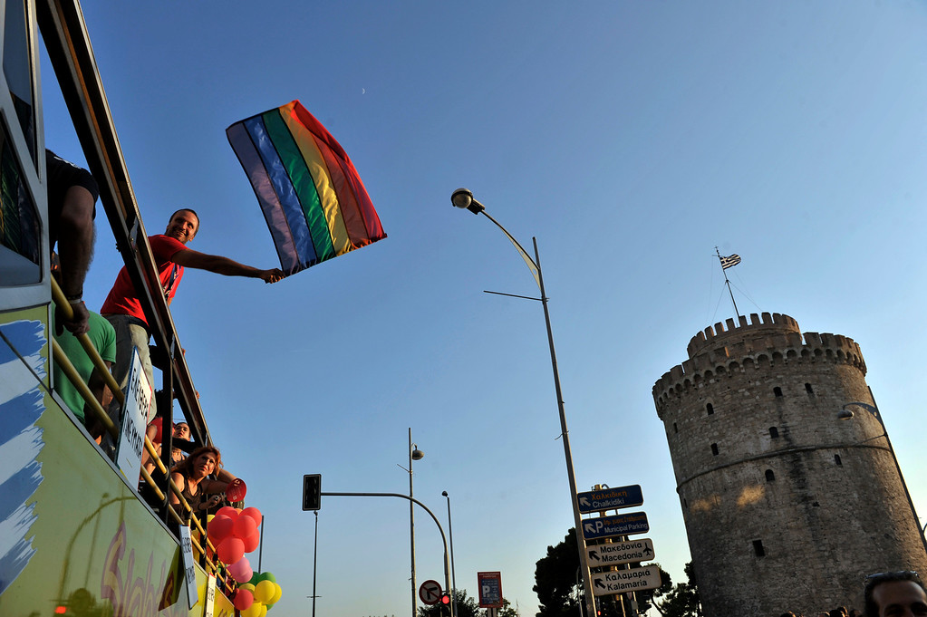 . A man waves the rainbow flag as participants of the second gay pride march through the city of Thessaloniki on June 15, 2013. Thousands of people took part in a march organized by Greece\'s gay and lesbian community in the northern Greek city of Thessaloniki.AFP PHOTO /Sakis  MITROLIDIS/AFP/Getty Images
