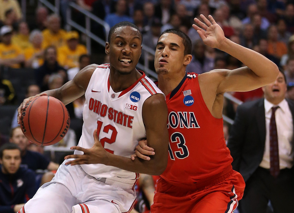 . Sam Thompson #12 of the Ohio State Buckeyes drives on Nick Johnson #13 of the Arizona Wildcats in the first half during the West Regional of the 2013 NCAA Men\'s Basketball Tournament at Staples Center on March 28, 2013 in Los Angeles, California.  (Photo by Jeff Gross/Getty Images)