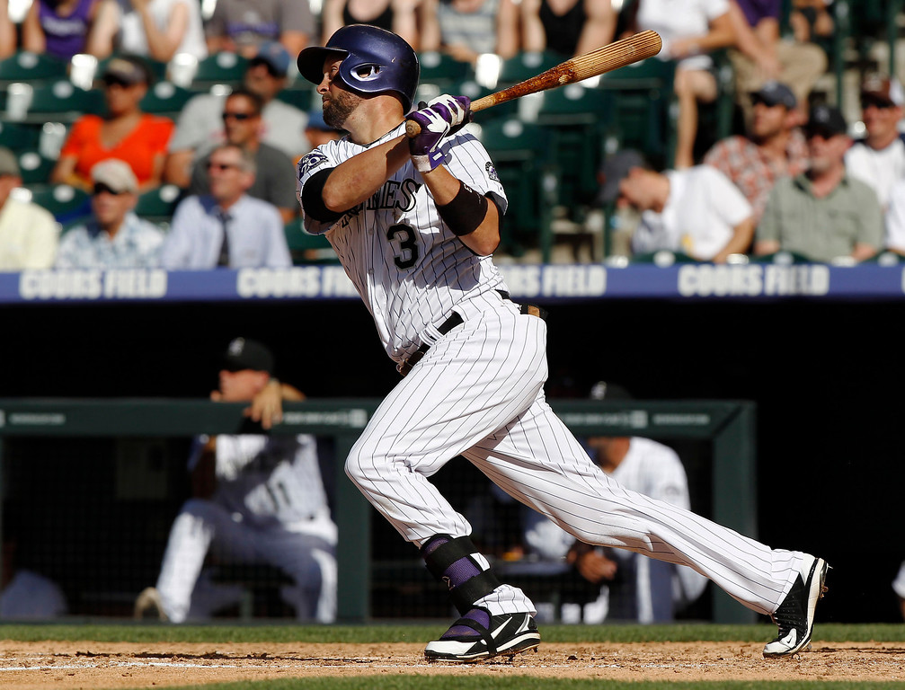 . Colorado Rockies\' Michael Cuddyer follows the flight of his fly out against the New York Mets in the fourth inning of a baseball game in Denver on Thursday, June 27, 2013. Cuddyer extended his career-best hitting streak to 24 games in the second inning. (AP Photo/David Zalubowski)