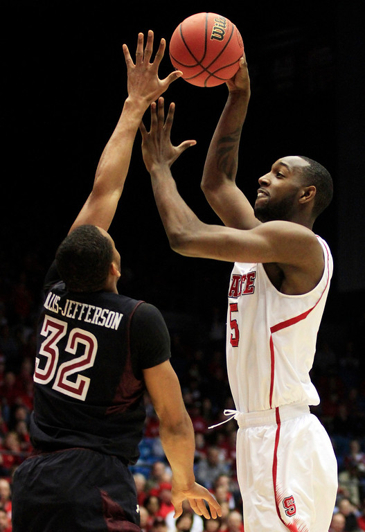 . CORRECTS BYLINE - North Carolina State forward C.J. Leslie (5) shoots over Temple forward Rahlir Hollis-Jefferson (32) during the first half of a second-round game at the NCAA college basketball tournament, Friday, March 22, 2013, in Dayton, Ohio. (AP Photo/Skip Peterson)