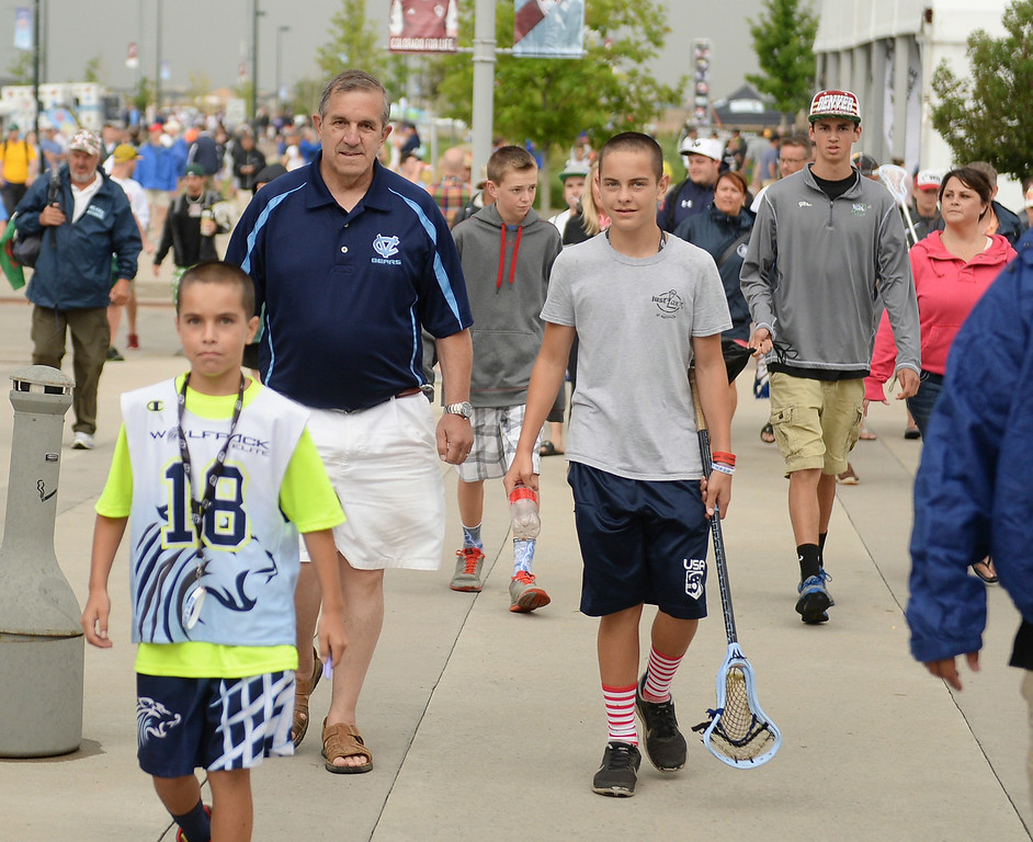 . World Lacrosse Championships ticket holders were shepherded into Dick\'s Sporting Goods Park after a weather delay was called Tuesday night, July 15, 2014.   Photo by Karl Gehring/The Denver Post