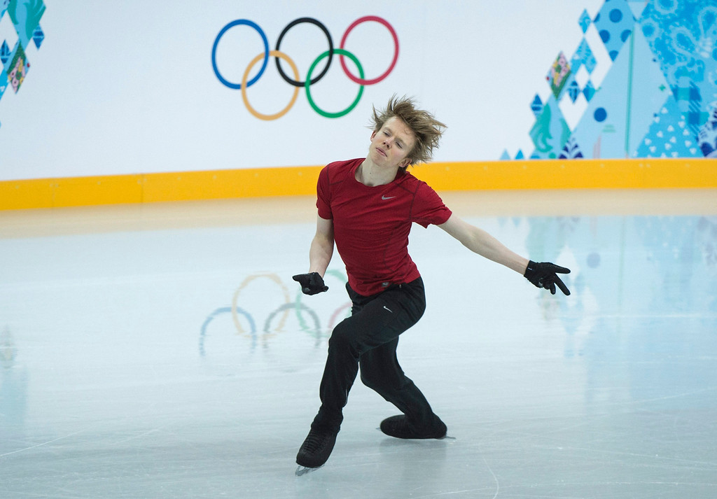 . Canada\'s Kevin Reynolds skates his routine during a practice session at the Sochi Winter Olympics Tuesday, Feb. 4, 2014 in Sochi.  (AP Photo/The Canadian Press, Paul Chiasson)