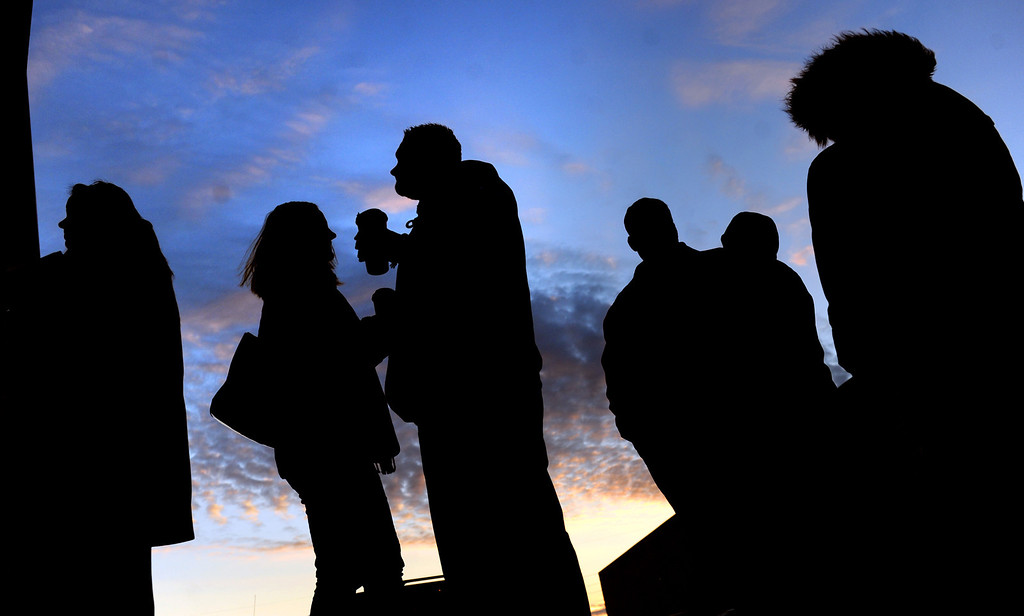 . As the sun begins to set, people wait for the opening of Toys R\' Us in York, Pa. for Black Friday shopping on Thursday, Nov. 28, 2013. (AP Photo/York Daily Record, Jason Plotkin)