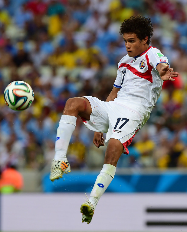 . Costa Rica\'s midfielder Yeltsin Tejeda kicks the ball during a Group D football match between Uruguay and Costa Rica at the Castelao Stadium in Fortaleza during the 2014 FIFA World Cup on June 14, 2014.     AFP PHOTO / RONALDO SCHEMIDT