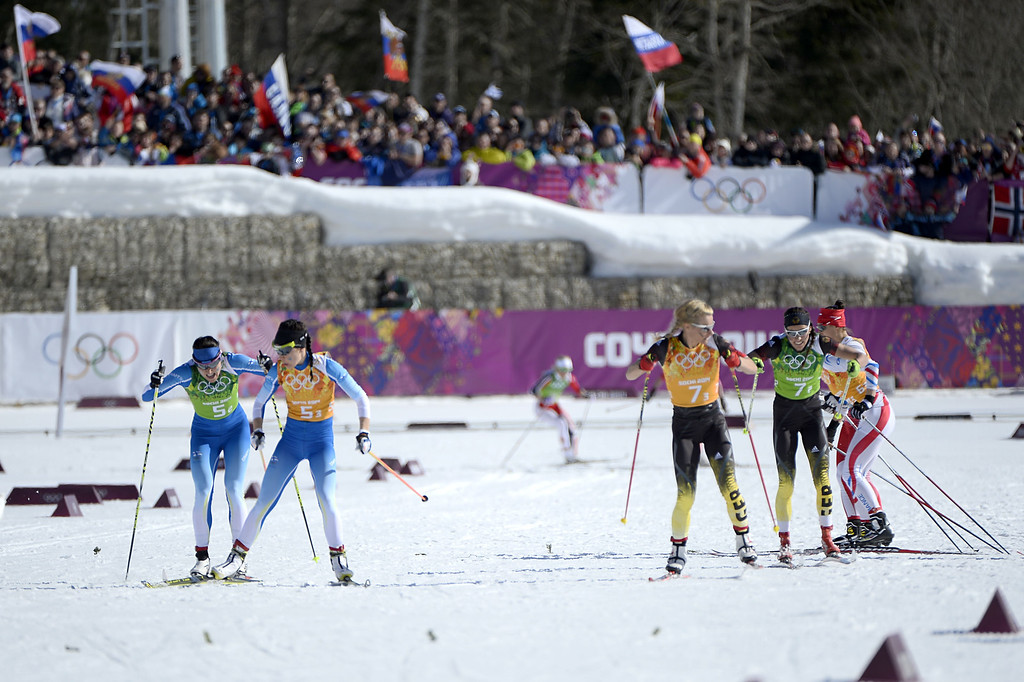 . Finland\'s Aino-Kaisa Saarinen (L) tags teammate Kerttu Niskanen as Germany\'s Stefanie Boehler (R) reaches teammate Claudia Nystad in the Women\'s Cross-Country Skiing 4x5km Relay at the Laura Cross-Country Ski and Biathlon Center during the Sochi Winter Olympics on February 15, 2014, in Rosa Khutor, near Sochi. PIERRE-PHILIPPE MARCOU/AFP/Getty Images