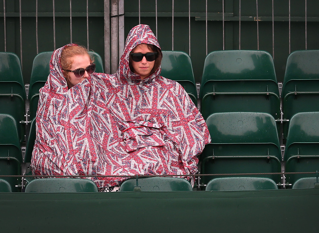 . LONDON, ENGLAND - JULY 02:  Spectators sit on court 18 shelter after rain delays play on day eight of the Wimbledon Lawn Tennis Championships at the All England Lawn Tennis and Croquet Club at Wimbledon on July 2, 2013 in London, England.  (Photo by Peter Macdiarmid/Getty Images)