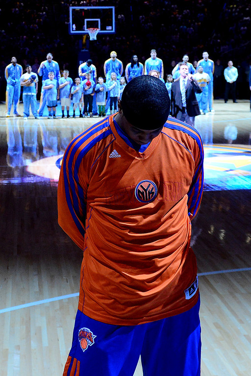 . DENVER, CO - MARCH 13: Carmelo Anthony (7) of the New York Knicks stands for the National Anthem with his former team, the Denver Nuggets, in the background before the first half of action. The Denver Nuggets play the New York Knicks at the Pepsi Center. (Photo by AAron Ontiveroz/The Denver Post)