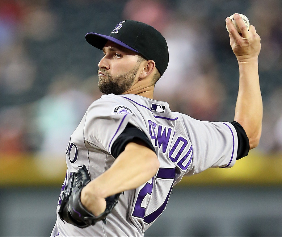 . Starting pitcher Tyler Chatwood #27 of the Colorado Rockies pitches against the Arizona Diamondbacks during the MLB game at Chase Field on April 29, 2014 in Phoenix, Arizona.  (Photo by Christian Petersen/Getty Images)