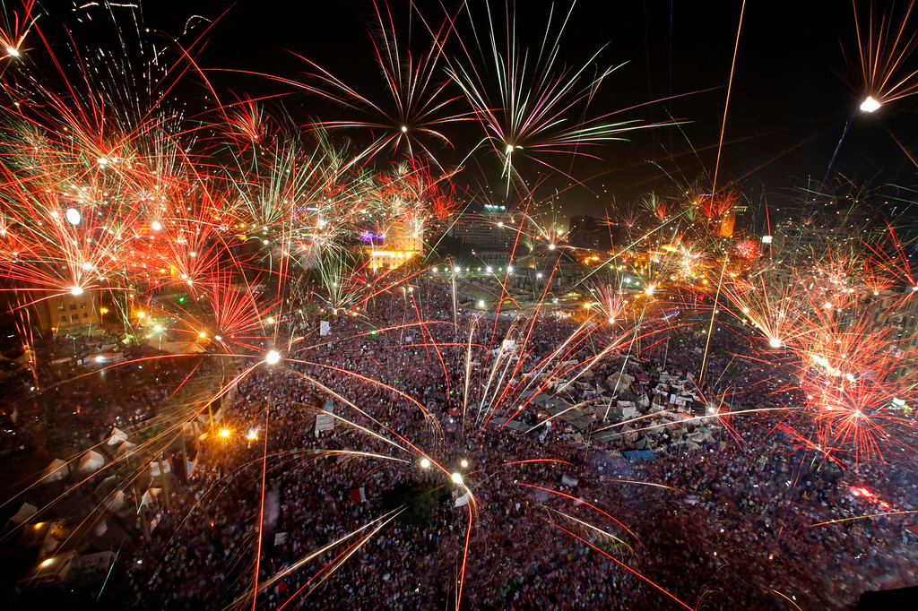 """. Fireworks light the sky as opponents of Egypt\'s Islamist President Mohammed Morsi celebrate in Tahrir Square in Cairo, Egypt, Wednesday, July 3, 2013. A statement on the Egyptian president\'s office\'s Twitter account has quoted Mohammed Morsi as calling military measures \""""a full coup.\"""" The denouncement was posted shortly after the Egyptian military announced it was ousting Morsi, who was Egypt\'s first freely elected leader but drew ire with his Islamist leanings. The military says it has replaced him with the chief justice of the Supreme constitutional Court, called for early presidential election and suspended the Islamist-backed constitution.  (AP Photo/Amr Nabil)"""