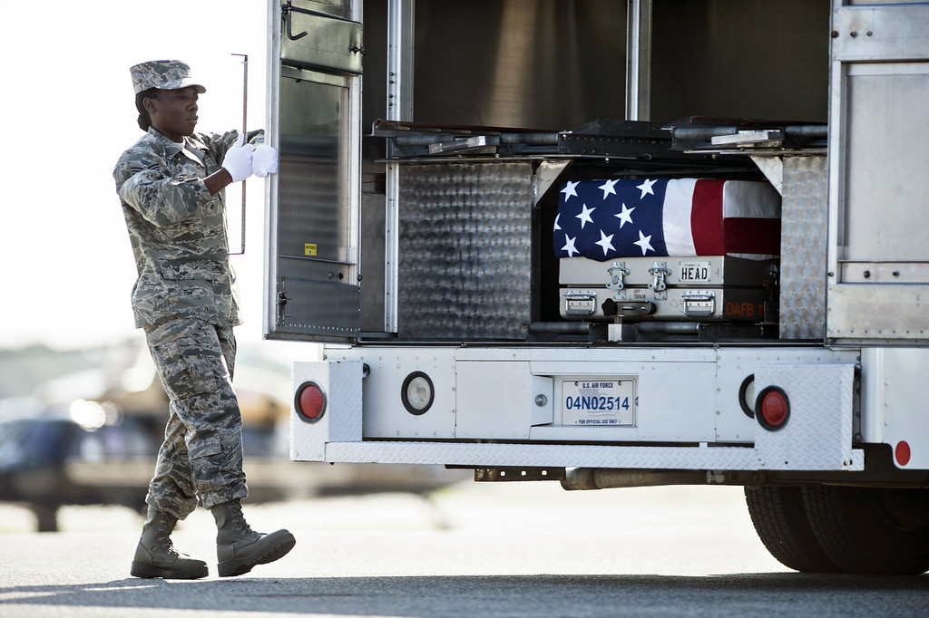 . A transfer case with the remains of US Army Maj. Gen. Harold J. Greene is seen, as a member of the US Air Force closes the doors of the vehicle during a dignified transfer  at Dover Air Force Base August 7, 2014 in Delaware.  AFP PHOTO/Brendan SMIALOWSKI/AFP/Getty Images