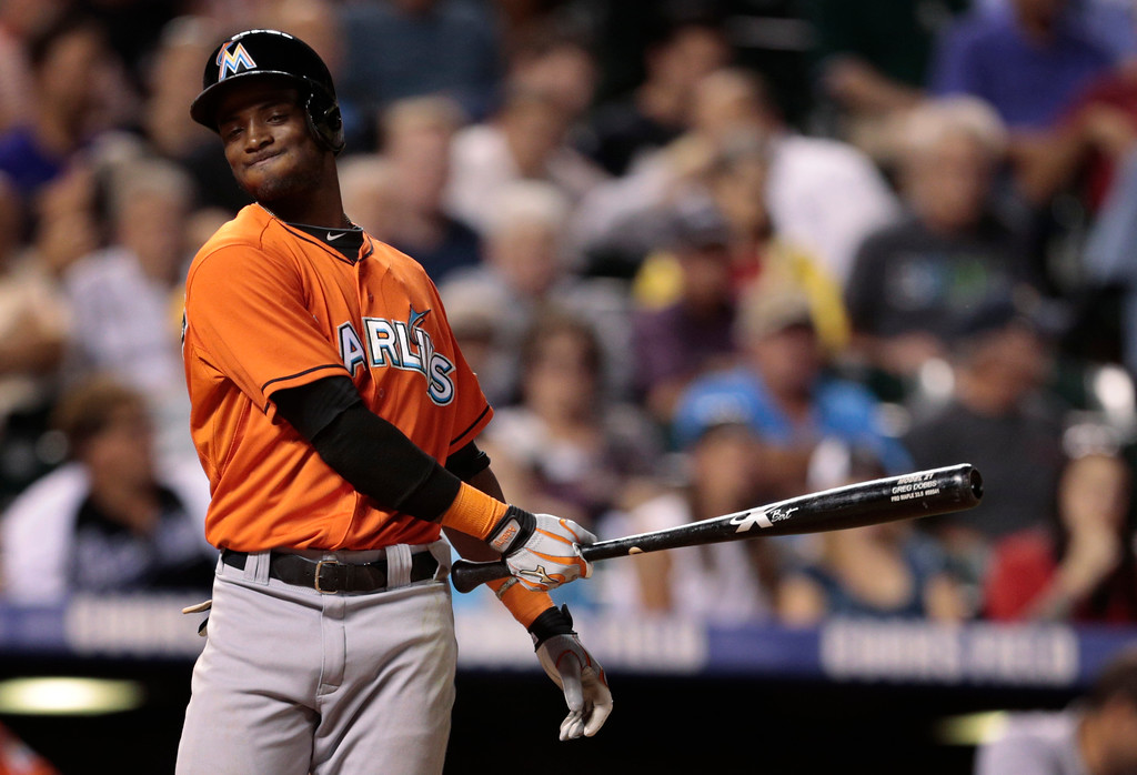 . Florida Marlins\' Adeiny Echavarria reacts to a called strike in the seventh inning of a baseball game against the Colorado Rockies in Denver, Wednesday, July 24, 2013. (AP Photo/Joe Mahoney)