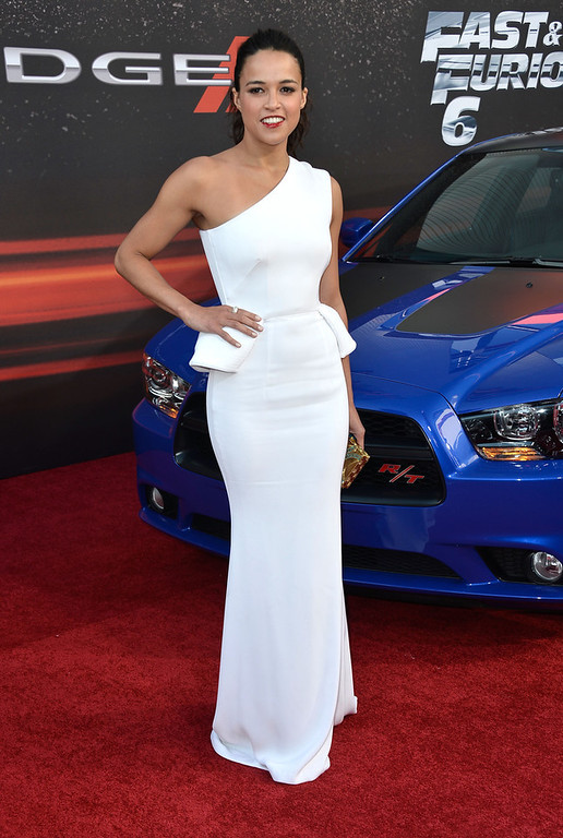 """. Actress Michelle Rodriguez arrives at the Premiere Of Universal Pictures\' \""""Fast & Furious 6\"""" on May 21, 2013 in Universal City, California.  (Photo by Frazer Harrison/Getty Images)"""